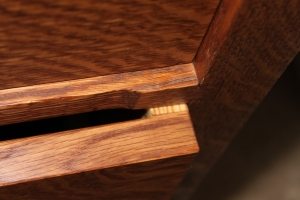 Drawer divider showing sliding dovetail joint with recess to keep divider inset from the plane of the case front.