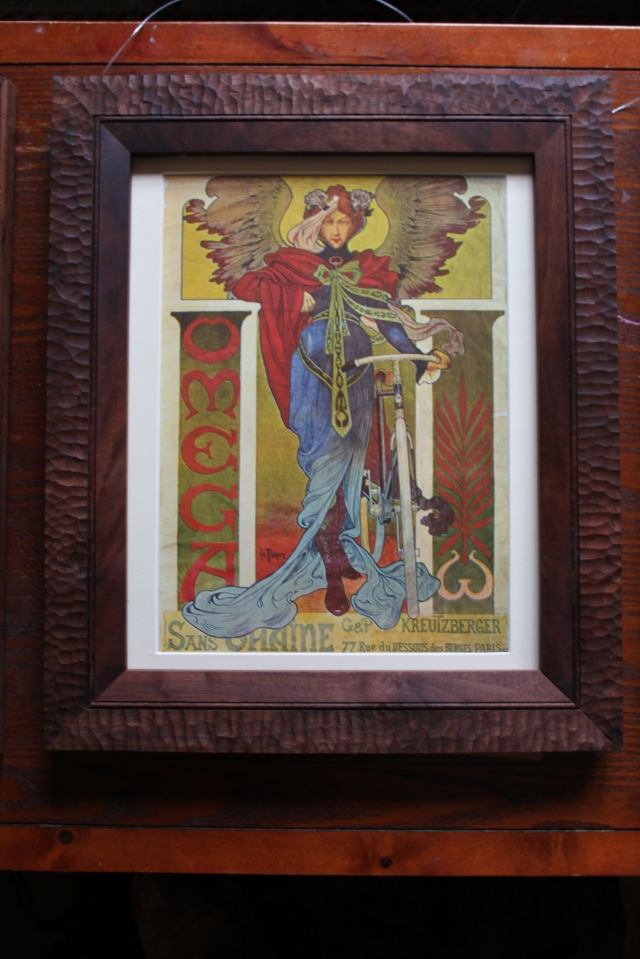 winged women and bike print with walnut frame -$175
